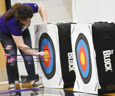 Campbellsville Middle School sixth-grader Madison Philpott pulls her arrows from the target.