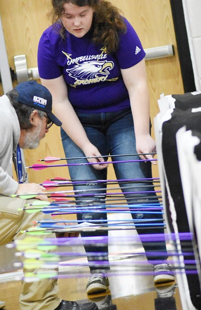 Campbellsville Middle School sixth-grader Madison Philpott gets some help calculating her score.