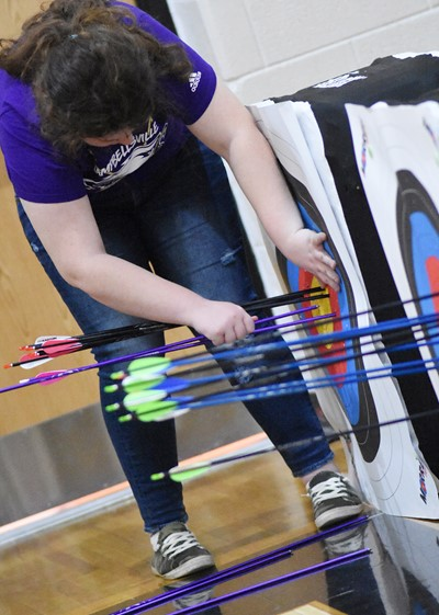 Campbellsville Middle School sixth-grader Madison Philpott pulls her arrows from her target.