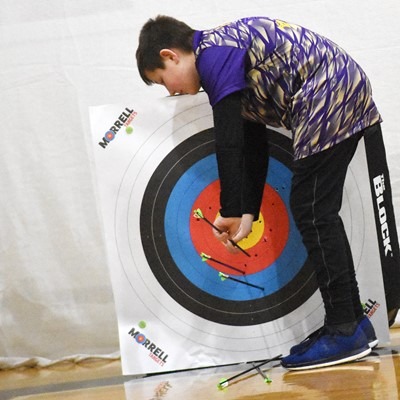 Campbellsville Middle School sixth-grader Grayson Dooley pulls his arrows from his target.
