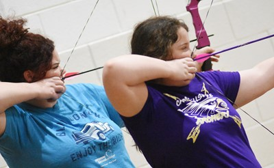 CHS senior Shallan Philpott, at left, and her sister Madison, a sixth-grader at Campbellsville Middle School, take aim.