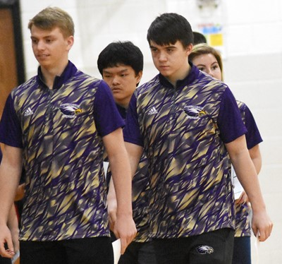 CHS junior Arren Hash, at left, and senior Cole Kidwell and their teammates prepare to shoot.