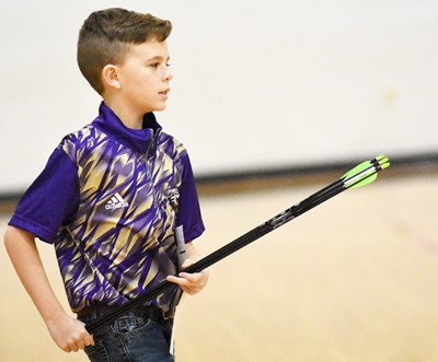 Campbellsville Middle School sixth-grader Brayden Judd walks to the shooting line.