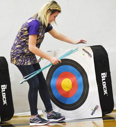 CHS senior Lauryn Agathen removes her arrows from her target.
