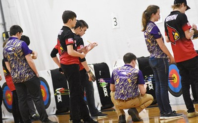 CHS archers, from left, senior Cole Kidwell, freshman Seth Hash and sophomore MaCayla Falls calculate their scores.