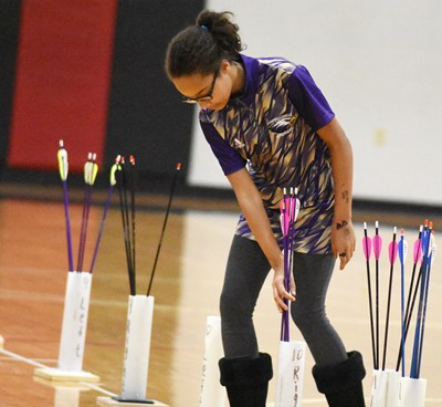 Campbellsville Middle School seventh-grader Lillian Sears places her arrows in her quiver.