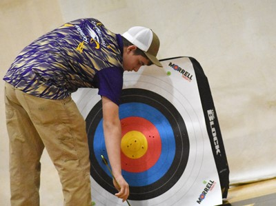 Campbellsville Middle School eighth-grader Ashton Davis removes his arrows from his target.