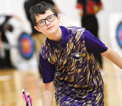 Campbellsville Middle School eighth-grader David Hughes places his arrows in his quiver.