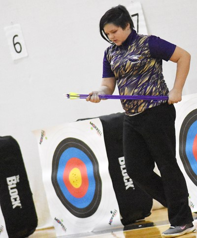 Campbellsville Middle School seventh-grader Mellany Parker removes her arrows from her target.