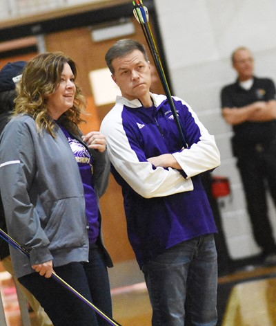 CHS archery coaches Cathy Falls, at left, and Chris Kidwell talk during the shoot.