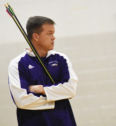 CHS archery coach Chris Kidwell watches his archers.