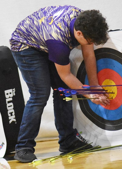 Campbellsville Middle School eighth-grader Maddox Lawler removes his arrows from his target.