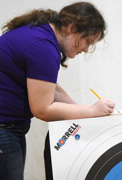 Campbellsville Middle School sixth-grader Madison Philpott counts her score.
