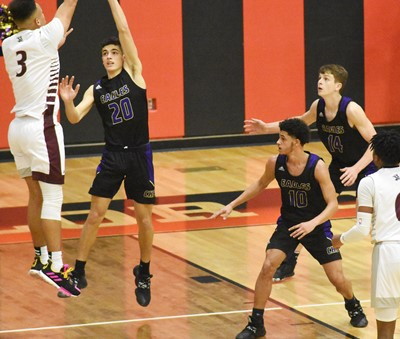 CHS junior Kameron Smith, at left, jumps to block a shot.