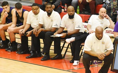 "From left, CHS assistant coaches Ricky Smith-Cecil, Chris ""Scoop"" Smith, Will Griffin and Ben Davis and head coach Anthony Epps watch their players."