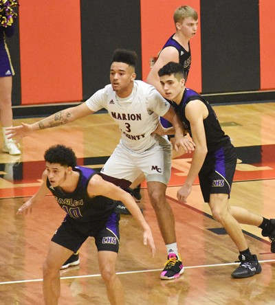 CHS senior Mikael Vaught, in front, and junior Kameron Smith play defense.