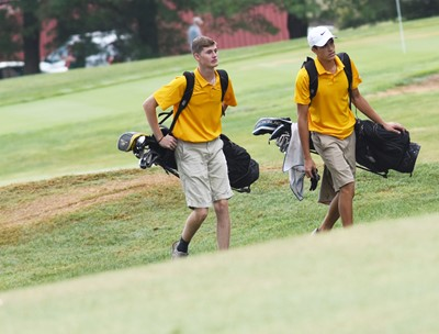 CHS juniors Tristin Faulkner, at left, and Kameron Smith walk to start their round.