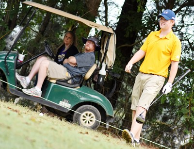 CHS junior Colin Harris tees off, as his parents Starr and David watch.