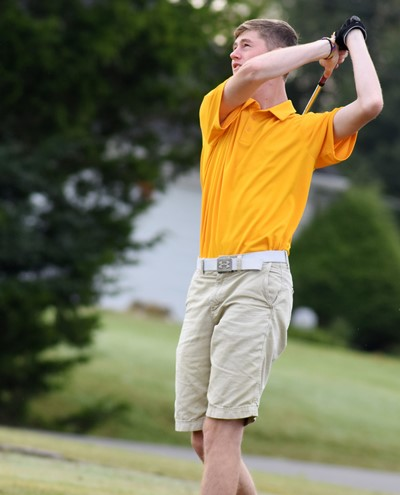 CHS junior Tristin Faulkner practices his tee shot.