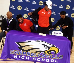 "CHS senior Malachi Corley recently announced that he will continue his football career at Western Kentucky University this fall. He was honored in a special ceremony with friends and family. From left are his stepfather Wilando ""Chop"" Bridgewater, his brother Micah, who graduated from CHS in 2017, Corley and his mother Latonya Bridgewater."