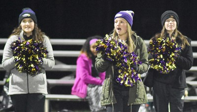 From left, CHS seniors Alli Wilson, Kaleigh Hunt and Gracyne Hash cheer for the Eagles.