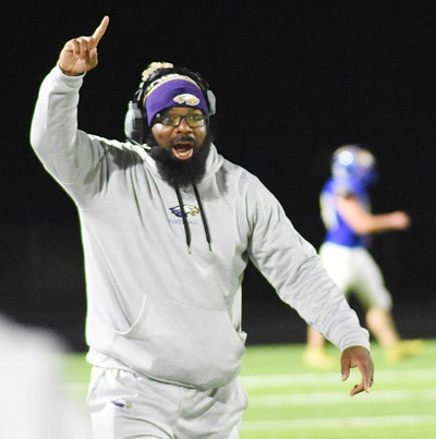 CHS football assistant coach Will Griffin celebrates a touchdown.