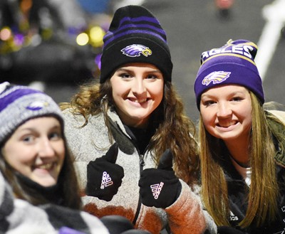 From left, CHS seniors Zoe McAninch, Alli Wilson and Kaleigh Hunt warm up during halftime.