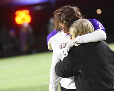 CHS senior Gideon Richards receives a hug after the game.