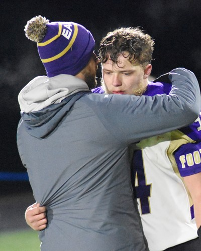 CHS senior Devon Reardon receives a hug from football assistant coach Tyler Hardy after the game.