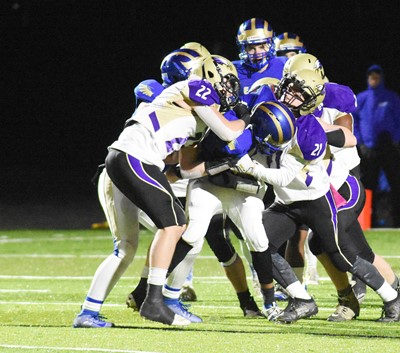 CHS seniors Tyler Gribbins, at left, and Gideon Richards tackle.