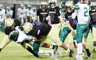 CHS junior Reggie Thomas, at left, and sophomore Bryson Williams tackle.