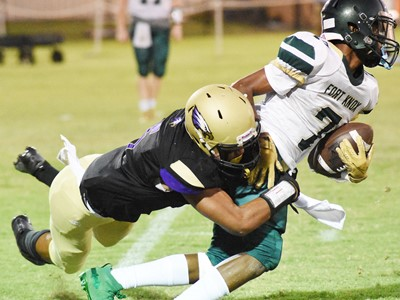 CHS junior Reggie Thomas tackles.