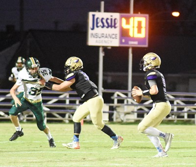 CHS junior Arren Hash looks to pass as senior Devon Reardon tackles for him.
