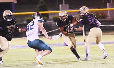 CHS junior Arren Hash passes the ball to junior Reggie Thomas.