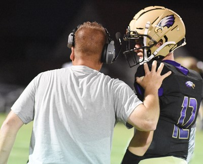 CHS junior Arren Hash talks with football head coach Dale Estes during a timeout.