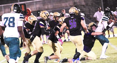 CHS senior Devon Reardon and his teammates tackle.