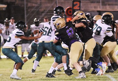 CHS senior Cole Kidwell and his teammates tackle.