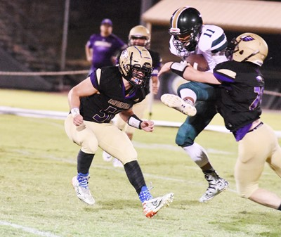 CHS seniors Luke Richards, at left, and Gideon Richards tackle.