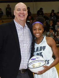 Campbellsville High School girls' basketball player Briante Gowdy, a sophomore, recently joined the school's 1,000 Point Club. She is pictured with head coach David Petett.