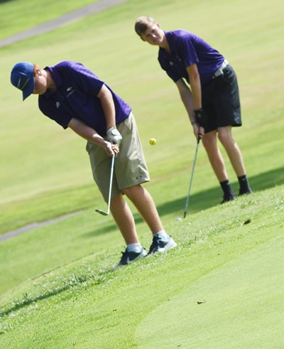 CHS junior Colin Harris practices a shot with classmate Tristin Faulkner.