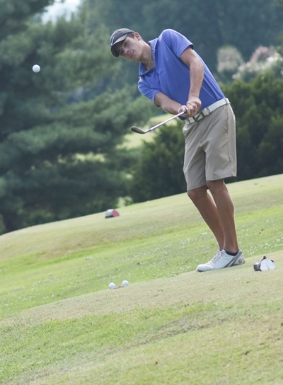 CHS junior Kameron Smith practices chipping.