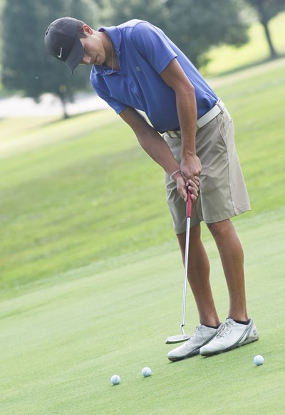CHS junior Kameron Smith practices putting.
