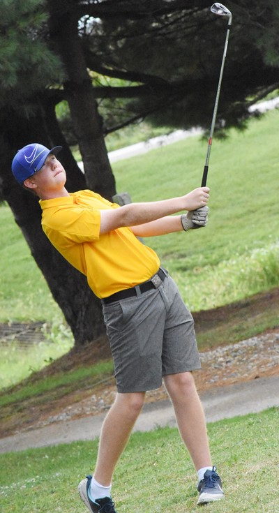 CHS junior Colin Harris tees off.