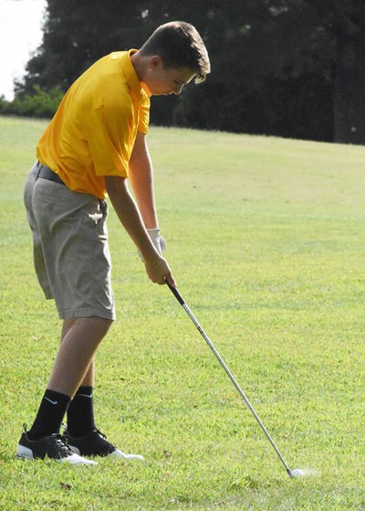 CHS freshman Bryce Newton hits the ball.