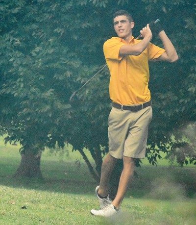 CHS junior Kameron Smith tees off.
