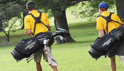 CHS juniors Kameron Smith, at left, and Colin Harris walk to their next shots.