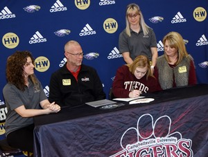 CHS senior Isabella Osborne recently signed a letter of intent to continue her education and swimming career at Campbellsville University. She is pictured with her parents, Brian Osborne and Kayce Reynolds and CU swim head coach Casey Bradstreet, at left, and Bekah Tilton, assistant coach.