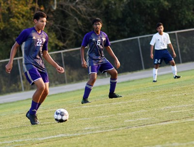 CHS sophomore Brice Spaw kicks the ball as classmate Yash Patel plays defense.