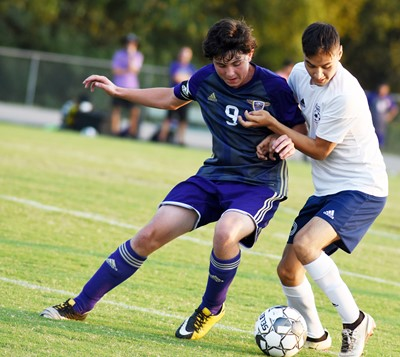 CHS sophomore Dakota Harris protects the ball.
