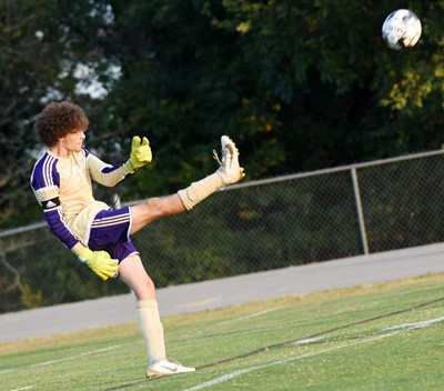 CHS senior Brennon Wheeler kicks the ball.